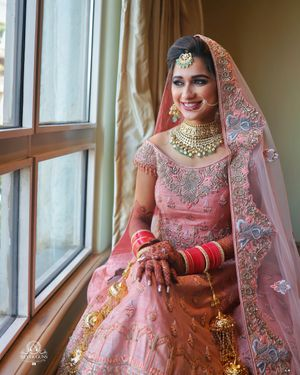 Pastel bridal lehenga with floral embroidery