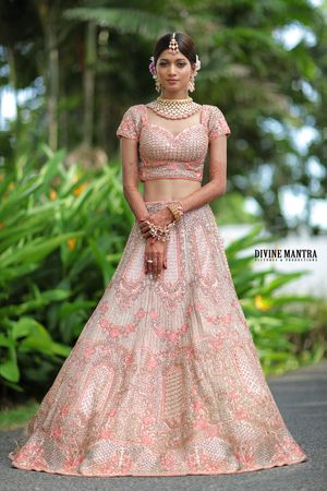 Morning bridal lehenga in light pink getting ready shot