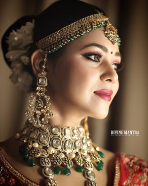 Polki bridal necklace and earrings with green beads