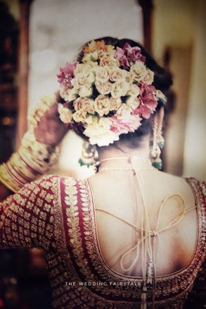 Bridal bun with loads of small flowers