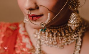 Bridal Nath with green beads close up shot