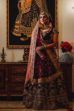 A bride in maroon lehenga with double dupatta