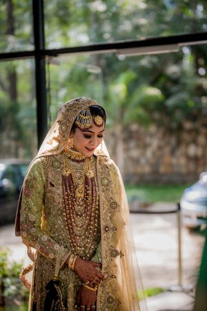 Muslim bridal look with gold anarkali and lots of jewellery