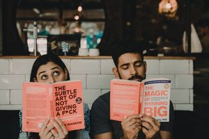 Quirky pre wedding shoot with books in cafe