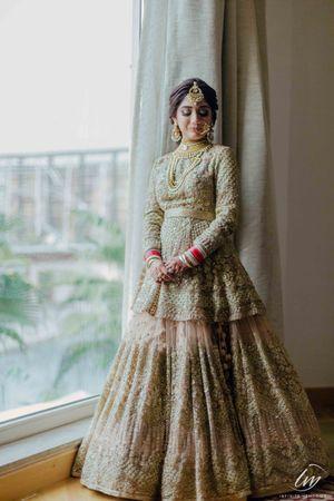 Silver bridal lehenga with peplum and full sleeved blouse