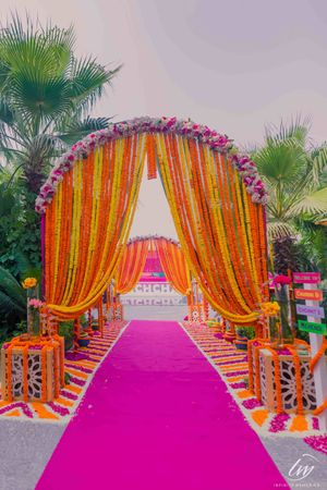 Mehendi entrance decor with floral archway