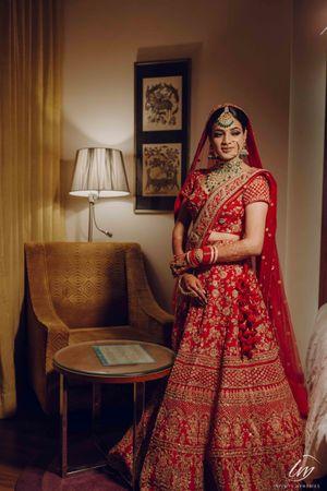 Bridal room photo in red lehenga on contrasting jewelery