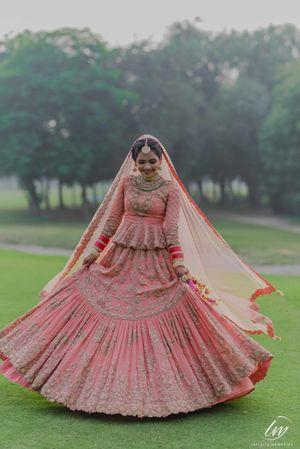 Offbeat peach bridal lehenga with peplum blouse