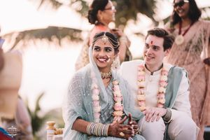 A smiling couple portrait, with the bride and groom in offbeat colors!