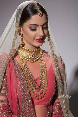 Simple bridal look with matte brown eyes and red lips