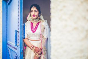 Layered pink necklace with off white bridal lehenga