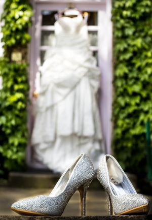 Silver Wedding Shoes with Gown in Background