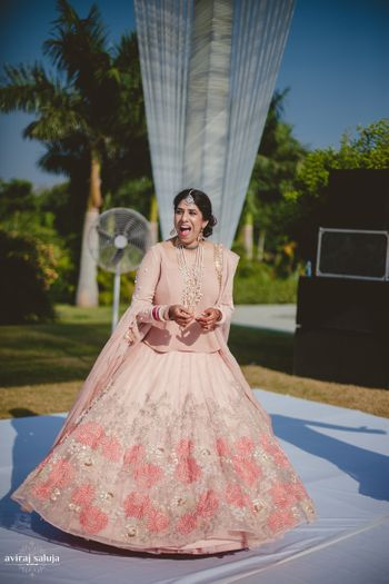 Photo of Soft pink bridal lehenga for morning wedding