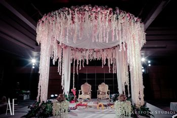 Pretty indoor mandap with pastel decor