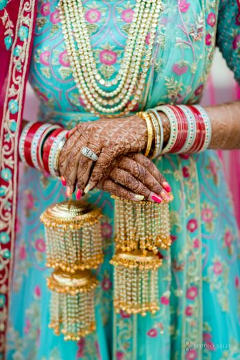 bridal hands with kaleere and a red chura