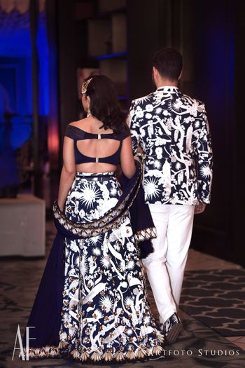 Photo of Twinning bride and groom in matching cocktail outfits