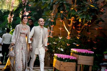 Matching bride and groom on mehendi in grey outfits