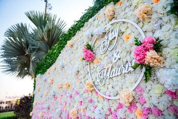Photo of floral wall with couple names in decor