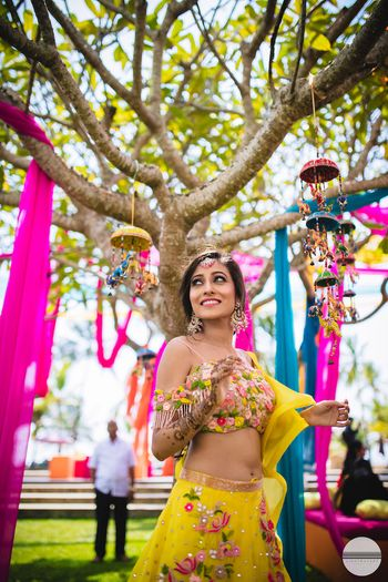 Unique props and a bride to be in yellow lehenga for her mehendi