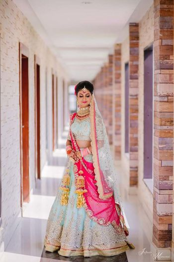 A bride in powder blue lehenga.
