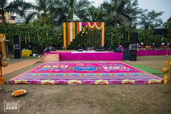 Photo of Mehendi decor with printed dance floor