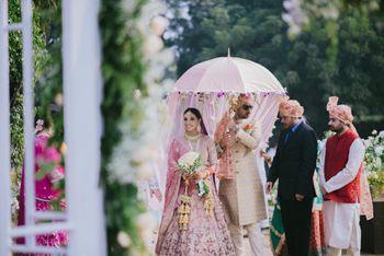 Gorgeous bridal entry under umbrella