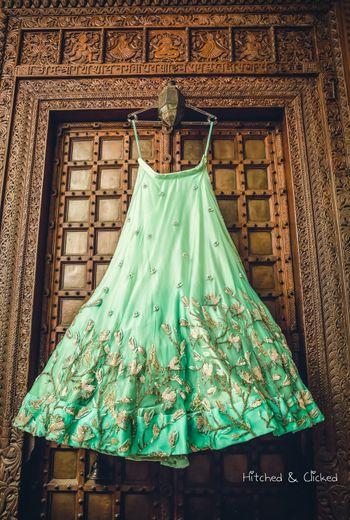 Green lehenga on hanger