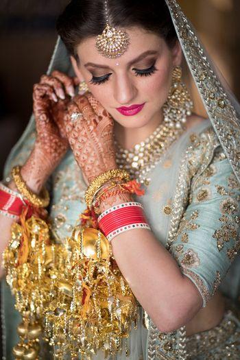 Photo of Seafoam bridal lehenga with kaleere