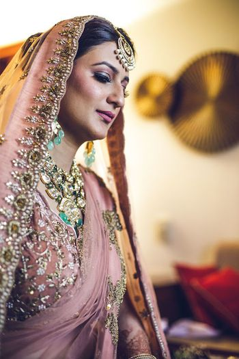 Photo of Sikh bride in dusty peach lehenga