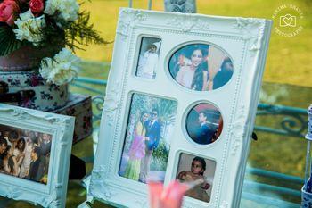 Photo of family photos as wedding decor