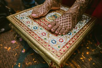 Photo of An intricate feet mehndi design.