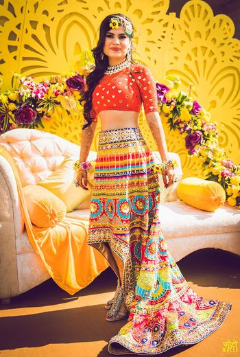 Photo of Unique mehendi lehenga with high low skirt