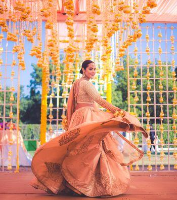 Twirling bride shot showing off lehenga