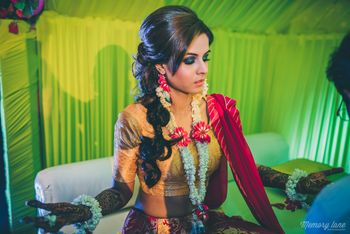 Photo of Mehendi braided hairstyle with smokey eyes