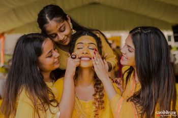 Cute haldi photo with bride and bridesmaids