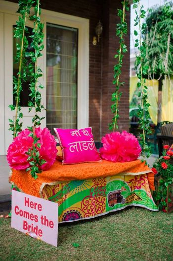 Photo of Bridal seat on mehendi with funky cushions