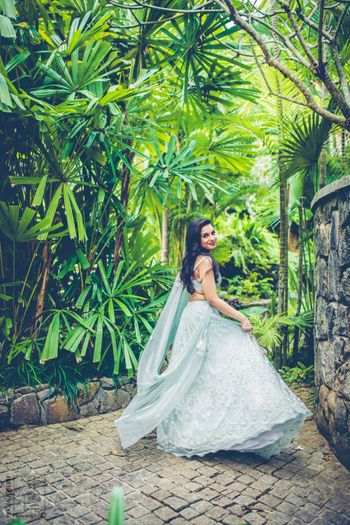 Bride twirling in light blue lehenga on engagement