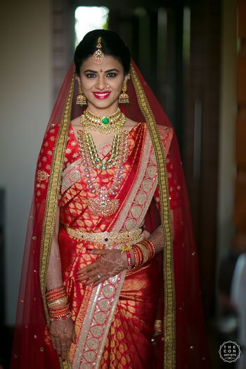 South Indian bridal look in red saree with dupatta