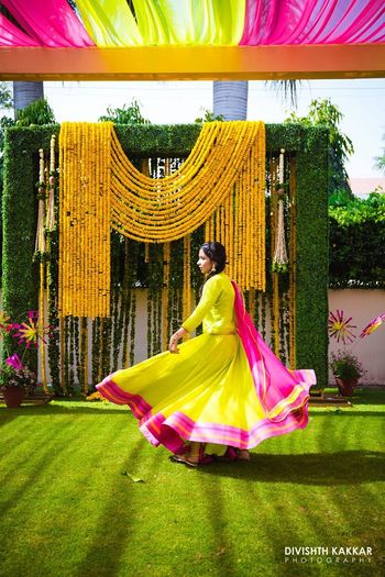 Photo of Lime green outfit for mehendi in pink and green