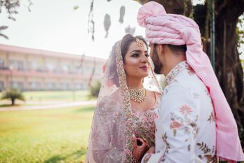 Photo of Floral sherwani matching bride and groom