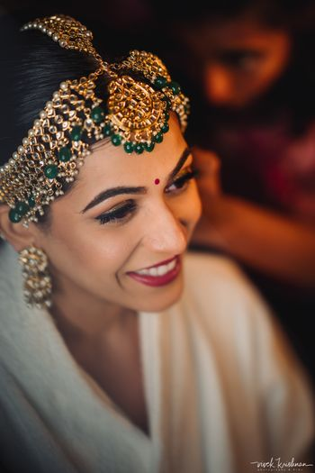 Photo of Gorgeous bridal mathapatti with green beads