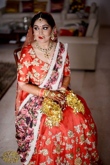 Red and gold bridal lehenga with floral print dupatta