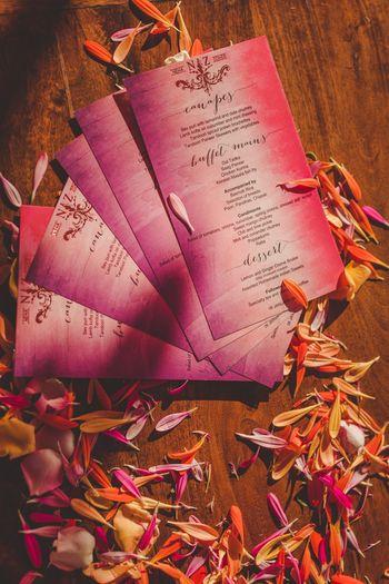 Ombre purple menu cards at wedding