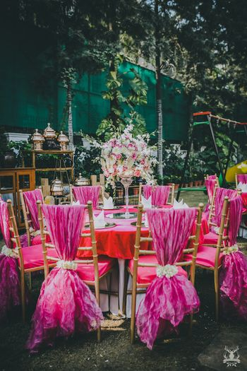 Photo of Pink decor theme mehendi table setting