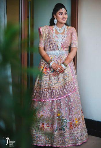 Light pink sangeet lehenga with diamond jewellery