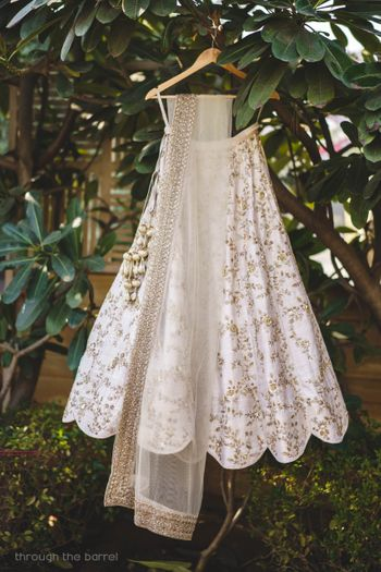 Minimal white bridal lehenga on hanger