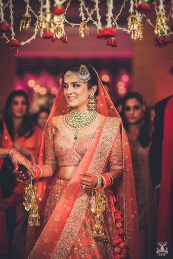 Photo of Pretty bridal portrait in peach lehenga