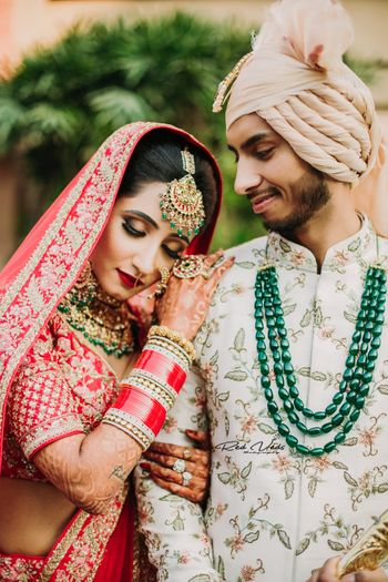 couple pose idea with groom in contrasting jewellery