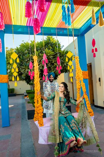 swing decor idea for mehendi with bride and groom