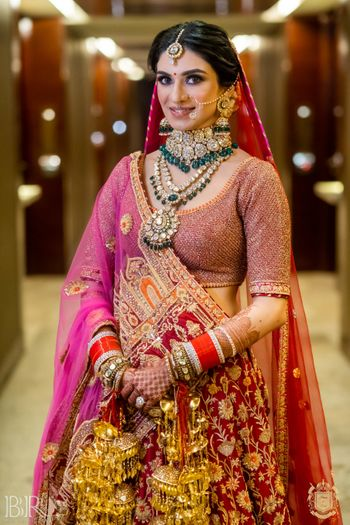 unique dupatta and layered bridal jewellery